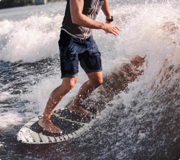 kelowna cannabis man surfing on okanagan lake